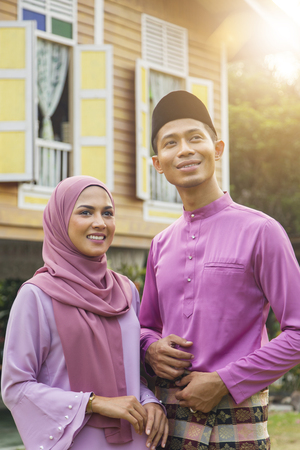 Mid adult Muslim couple standing outdoors Stock Photo