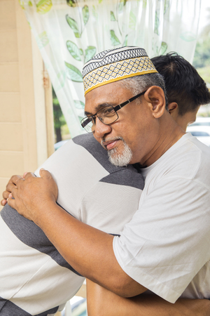 Man hugging his father