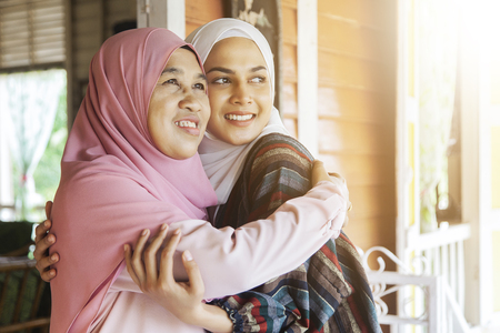 Mother hugs her daughter