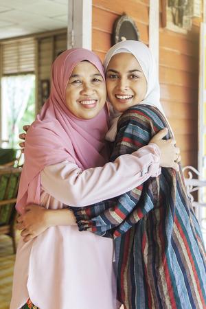 Mother hugs her daughter Stock fotó