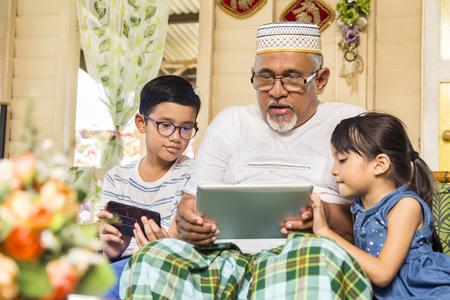 Senior man and children spending time together