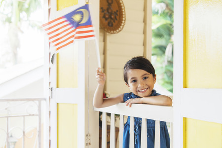 Malaysian girl waving national flags