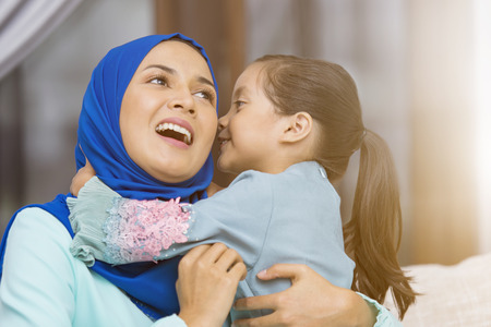 Muslim girl kissing her mother
