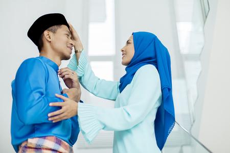 Mid adult Muslim couple during Eid al-Fitr