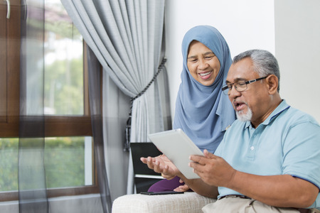 Senior couple using digital tablet Фото со стока