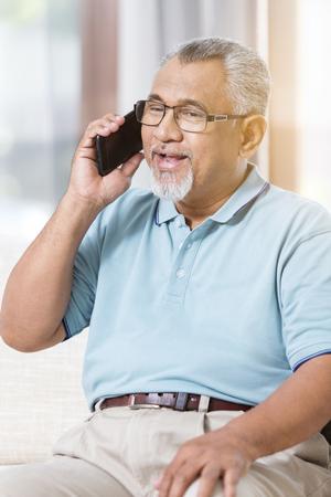 Senior man on the phone Фото со стока