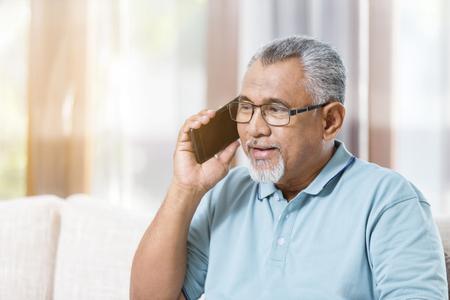 Senior man on the phone Banco de Imagens