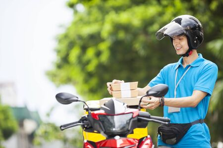 Food delivery man taking food from a bag