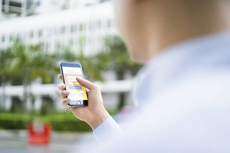 Man booking for flight through application on mobile phone