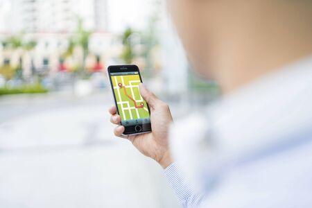 Man using gps navigation on his phone
