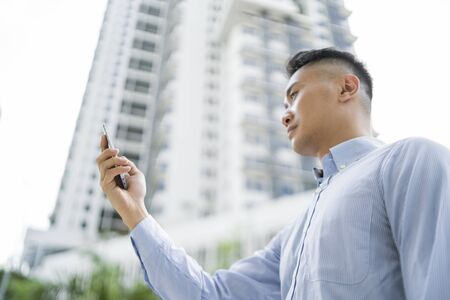 Man using his phone in a city