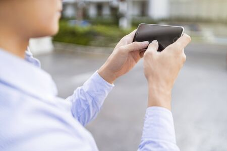 Man playing games on his phone