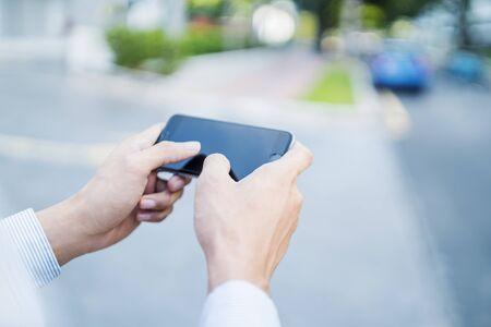Man playing game on mobile phone