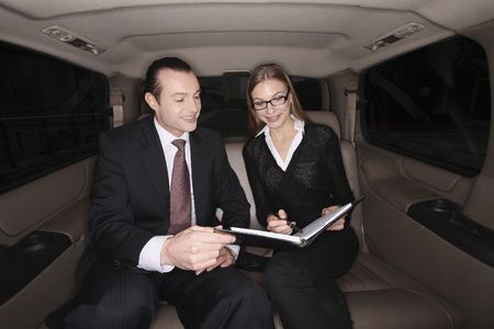 mpv: Business people having discussion in the car