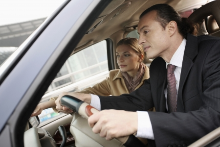 russian car: Businessman driving, businesswoman showing the way