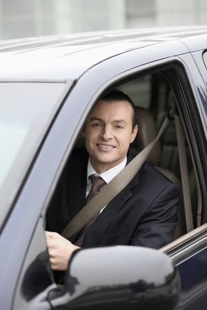 australian ethnicity: Businessman driving car Stock Photo