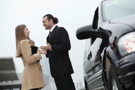 Businessman and businesswoman talking photo