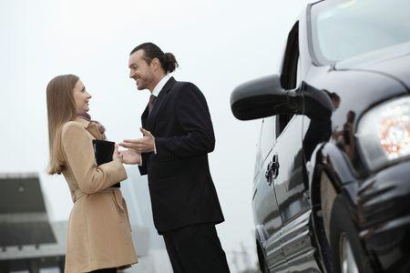 Businessman and businesswoman talking photo