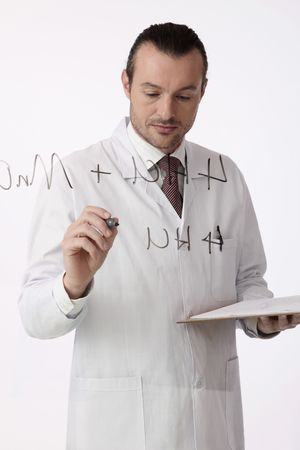 Scientist writing on a glass wall photo
