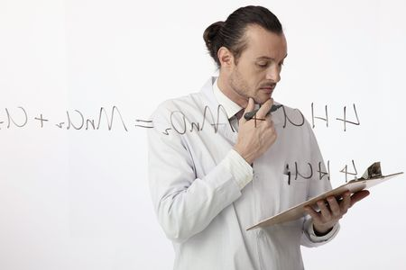 australian ethnicity: Scientist touching his chin while reading something on clipboard