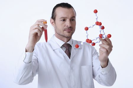 australian ethnicity: Scientist holding test tube and molecular model