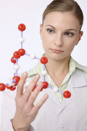 Scientist examining molecular model Stock Photo - 6521141