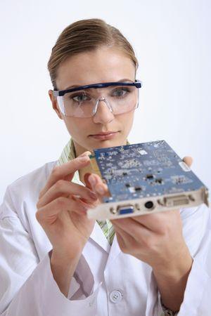 Scientist examining a circuit board photo