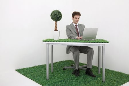 Man using laptop in garden office Stock Photo - 6521163