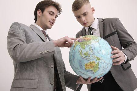 ukrainian ethnicity: Men looking at globe