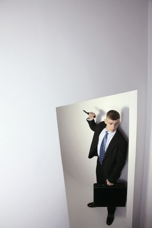 Man holding knife waiting at the entrance Stock Photo - 6546362