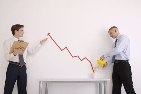 Man watering pot of line graph with another man is showing its business growth Stock Photo - 6546369