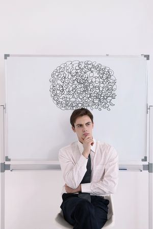 Man with scribbles drawing above his head, looking away photo