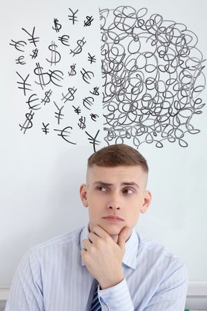 Man with half scribbles and currency sign drawings above his head Stock Photo