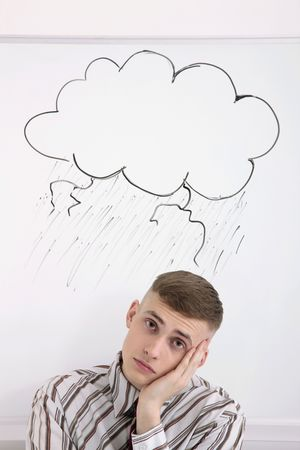 Man with storm cloud drawing above his head photo