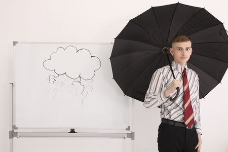 Man with opened umbrella standing beside drawing of storm clouds on white board Stock Photo - 6546385