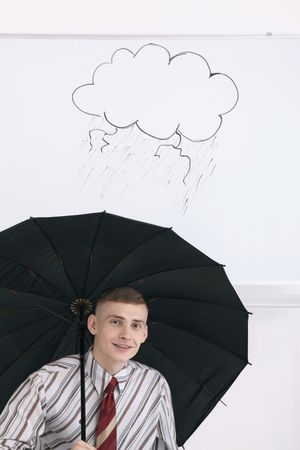 Man with opened umbrella under drawing of storm clouds on white board Stock Photo - 6546384