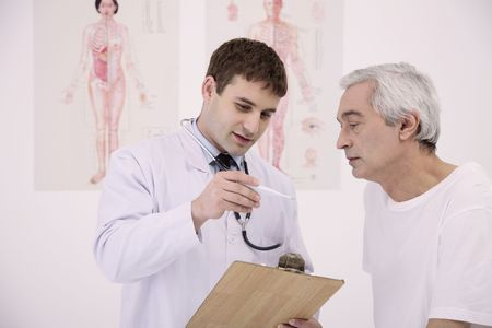 Doctor showing patient temperature on the thermometer Stock Photo - 6581070