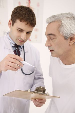 Doctor showing patient temperature on the thermometer Stock Photo - 6581071
