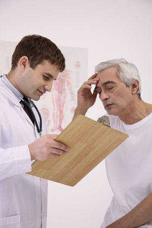 Doctor attending to his patient Stock Photo - 6581072