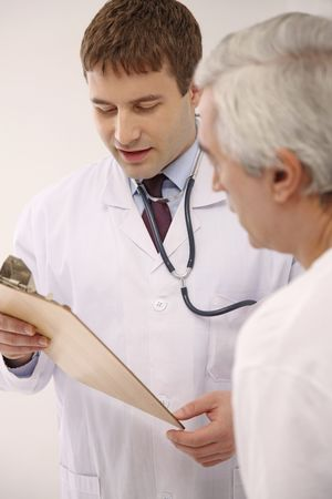 southeastern european descent: Doctor attending to his patient Stock Photo