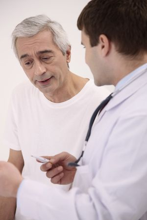 italian ethnicity: Doctor attending to his patient Stock Photo