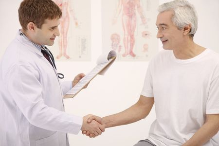 Doctor and patient shaking hands Stock Photo