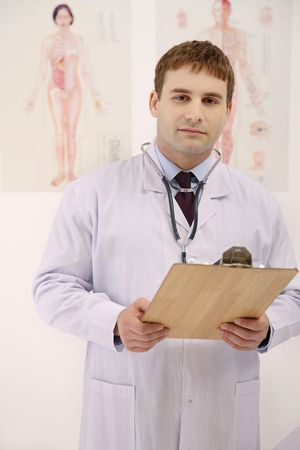 Doctor holding clipboard photo