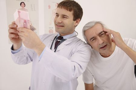 Doctor counting money, patient having headache Stock Photo - 6581083