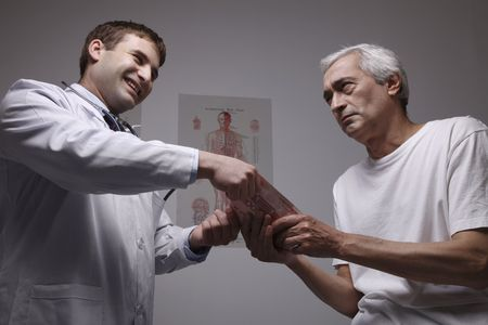 doctor holding money: Patient giving doctor money