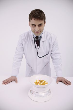 bulgarian ethnicity: Doctor standing with pills on the weight scale