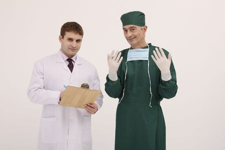 Doctor holding clipboard, surgeon showing surgical gloves photo