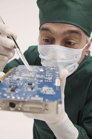 Surgeon fixing a circuit board photo