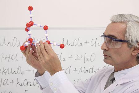 southern european descent: Scientist examining molecular model