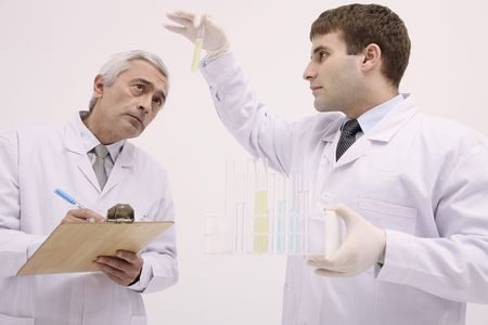 Scientists examining liquid in test tube Stock Photo - 6581140